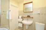 Bathroom with over bath shower