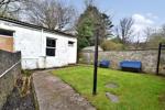 Rear garden and outhouse