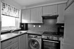 Modern fitted kitchen to front of property