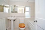 Bathroom with overbath electric shower