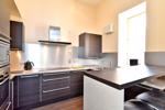 Open plan breakfast kitchen and living room