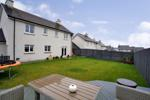 Fully enclosed rear garden with decked area
