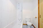 Bathroom with overbath shower